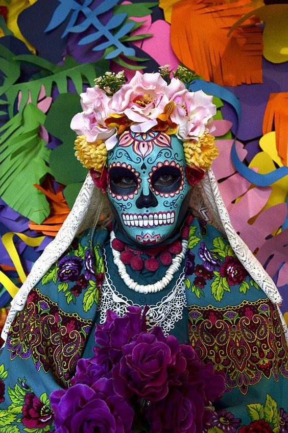 "Catrina Skull is a hand painted paper mache mask in full size with beautiful fabric flowers crown. There is no mass production; there is only the artist history José Guadalupe Posada was the creator of the image we call ""Catrina"" He was a Mexican painter and caricaturist famous for his illustrations of skulls and lithographs inspired by Mexican crime and folklore. Diego Rivera cited it as one of his artistic influences and called it: ""The prototype of the artist of the people""."