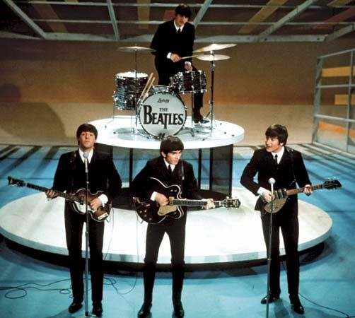 1964 - Beatles no Ed Sullivan Show. Com 73 milhões de expectadores, chegou a 86% da audiência.: