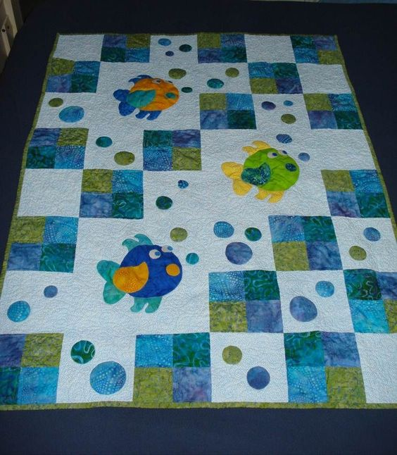 This quilt just makes me giggle.  Must be the fish blowing bubbles!  It looks like it would be fairly easy to do.: