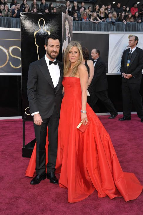 Actors Justin Theroux Left And Jennifer Aniston Arrive At The Oscars At The Dolby Theatre On Sunday Fe Strapless Dress Formal Valentino Gowns Fashion Costume