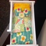 Close-up of custom Flower bedding for doll bunkbeds
