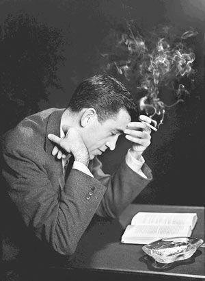 "Author JD Salinger reads from his novel ""The Catcher in the Rye""… (San Diego Historical Society / Getty Images)"