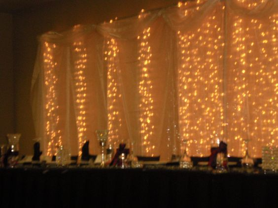 The backdrop and head table, at center of the backdrop were 2 crystal curtains