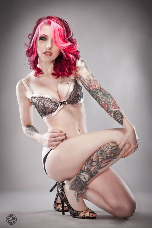 Girls with pink hair and tattoos ready