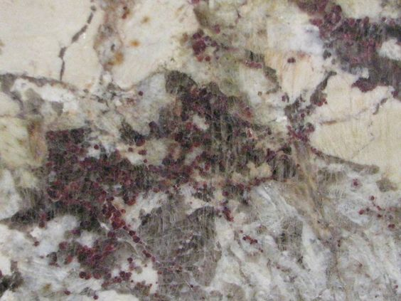 Ice Blue #granite from Brazil has a creamy white background with grey veins that range to a stunning blue in places. Sparkling quartz deposits are also littered around most slabs and are usually accompanied by very tiny specks of dark red to burgundy deposits.