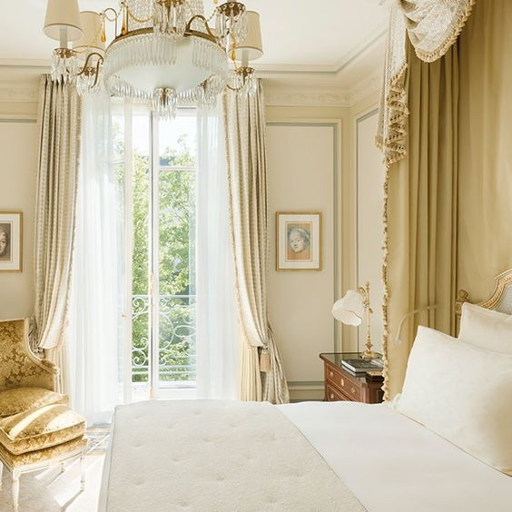 Gold accents in a Ritz Paris suite with luxurious paneled walls and decor #RitzParis