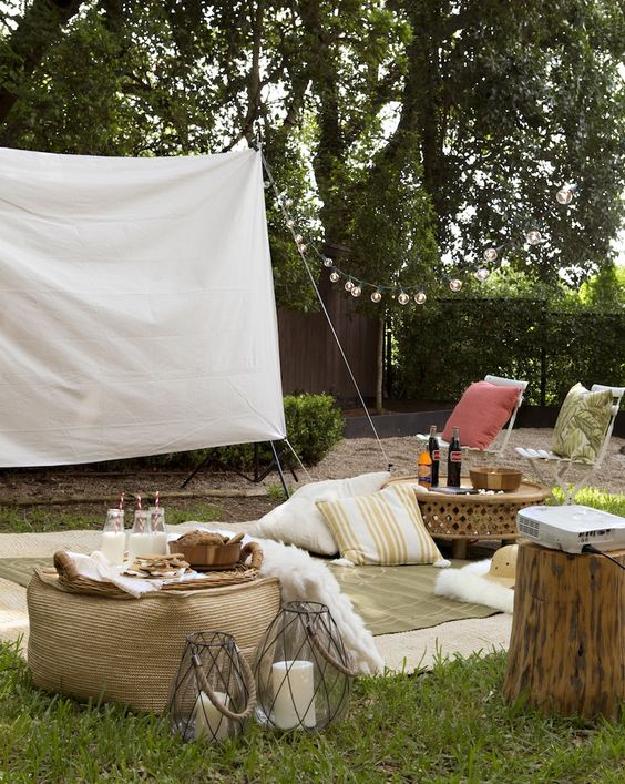 Outdoor movie night: set up canvas screen, projector, comfy cushions, have snacks and drinks on hand - Camille Styles:
