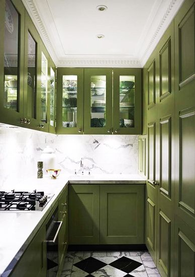 A Chic and Feminine Australian Apartment// Green kitchen cabinetry, marble backsplash
