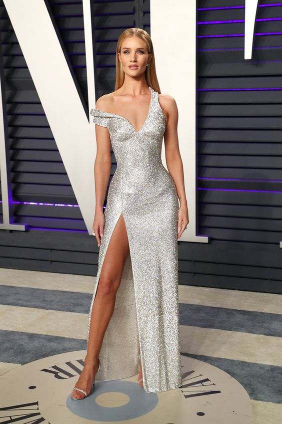 Rosie Huntington-Whiteley wore a sexy silver dress by Versace at the Vanity Fair Oscar Party in 2019. -- HollywoodLife