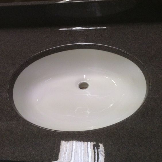 3300 cultured granite with cultured marble white bowl. Denmark marble