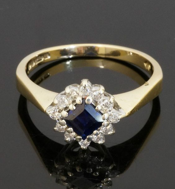 9Carat Yellow Gold Princess Cut Sapphire And Diamond Cluster Ring (Size N)  https://www.jollysjewellers.com/product/9carat-yellow-gold-princess-cut-sapphire-and-diamond-cluster-ring-size-n/