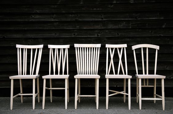 Lina Nordqvist's original prototypes of the Family Chairs, her exam project at Beckmans College of Design. A playful study of traditional Swedish stickback chairs.