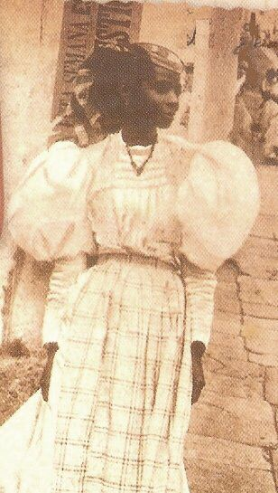 Turn of the 19C. Creole woman in her Sunday best. Old San Juan, Puerto Rico.Gauzes and Madras fabrics used. A free Black Puertorrican woman
