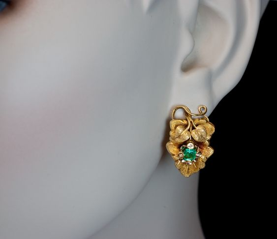 Victorian Gold and Emerald Grape Leaf Earrings and Brooch circa 1880. They are designed as stylized grape leaves embellished with emeralds and rose cut dia