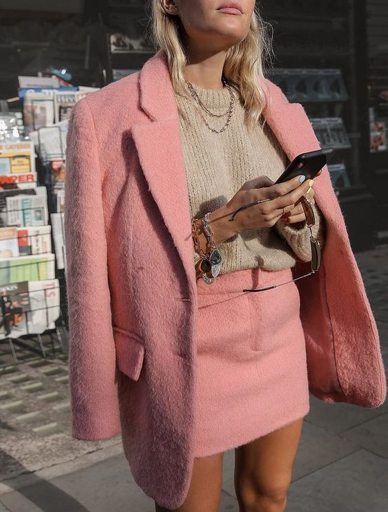 Blazer and Skirt Outfit Ideas: @wethepeoplestyle wears a pink blazer and mini skirt