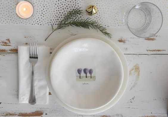 My neutral Swedish farmhouse Christmas tablescape with white, gold, and green, ready for its Swedish pancakes. #hellolovelystudio #christmasdecor #whitechristmas #placesetting
