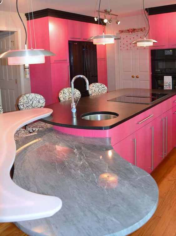 Deluxe kitchen apartmen idea with wooden flooring and pink - Pink kitchen cabinets ...