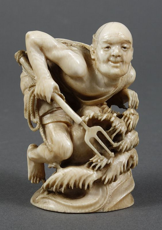 "JAPANESE CARVED IVORY OKIMONO - Portrayal of a fishermen with a trident attached to a rope standing in the waves waiting for a catch. Character marks to base. Condition good; minor age cracks on head. First half 20th century. 3.25""H"