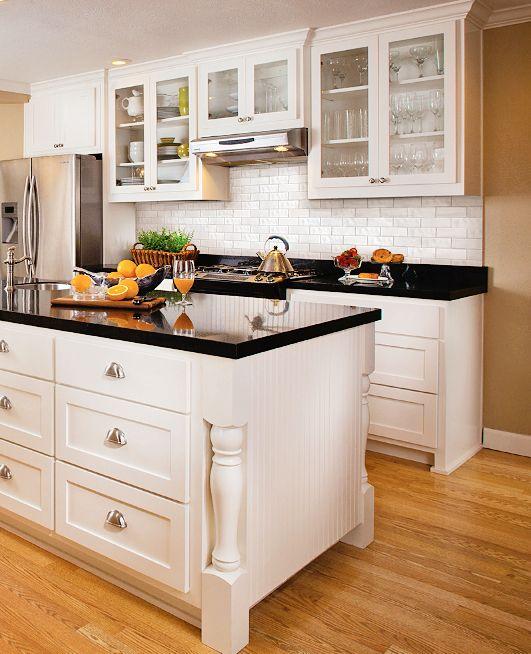 Subway tile back splash white cabinets nickel hardware black granite counters and golden - Kitchen counter backsplash ...