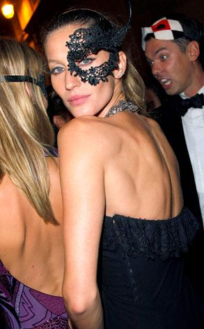 gisele at a masquerade ball in paris