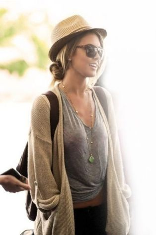 Audrina Patridge wearing low bun and fedora  Cute summer hats should be on every gals list of summer must-have accessories! Throw on your shades and sandals, splash on a bit of lotion and top off a casual summer do with a fabulous hat . . . and you're golden!