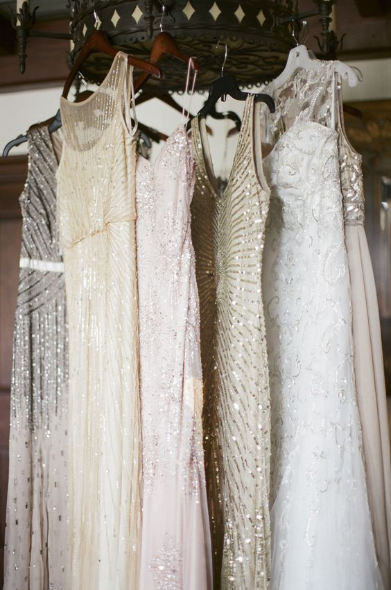 sparkly mix and match bridesmaids dresses   #sequins, #metallic  Photography: Ashley Seawell Photography - www.ashleyseawellphotography.com  Read More: http://www.stylemepretty.com/2014/12/15/romantic-sea-island-georgia-wedding/