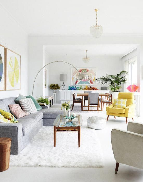 White Living And Dining Space With Grey Sofa Yellow Armchair And Bright Colours Livingroomlighting Bright Living Room Living Room Scandinavian Living Decor