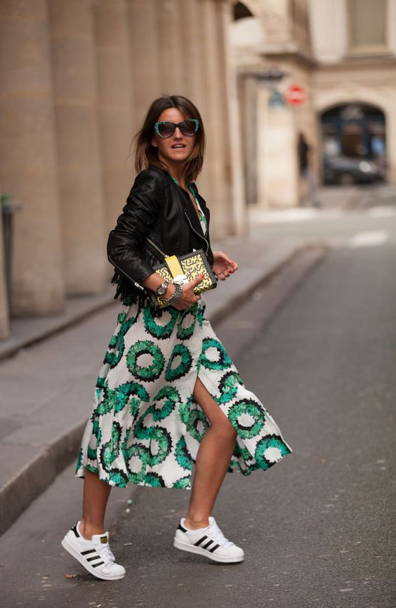 White and green patterned midi skirt with slit + black leather jacket + trainers