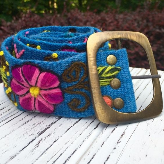 saleEmbroidered Flower Belt Peruvian sheeps wool embroidered belt, beautiful colors with a flower design.   Handmade and one of a kind. Simply stunning and a great pop of color to any outfit!   Measurements- 41 inch x 2 inch  The buckle is made of an alloy of zinc, copper and alluminium with a colored patina. Accessories Belts