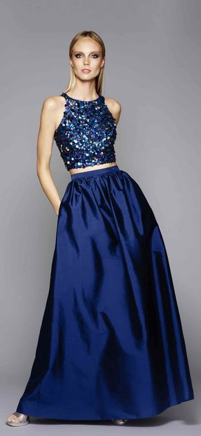 Large sequins alight a racer-style tank top that pairs back to a high waisted taffeta ball skirt.