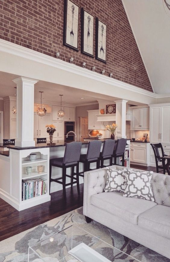 Pinned this for the idea of opening up our kitchen into vaulted ceiling sunroom creating open concept kitchen living area. For when we do big remodel.: