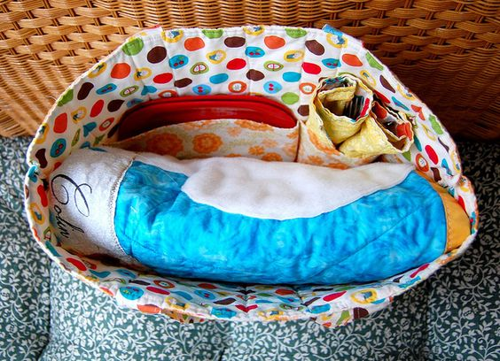 I'm seriously in love with the idea of this! (picnic in a bag - quilt, tote, napkins) The colors and styling, not so much, but the idea? FAB.