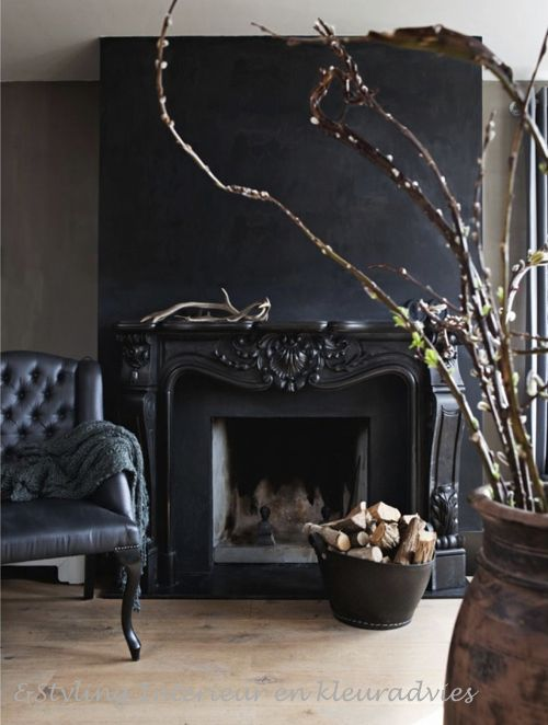 Black fireplace and feature wall.: