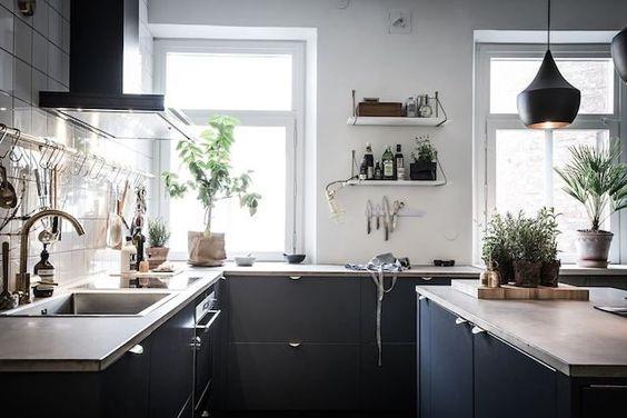 A Swedish apartment with dramatic dark shades