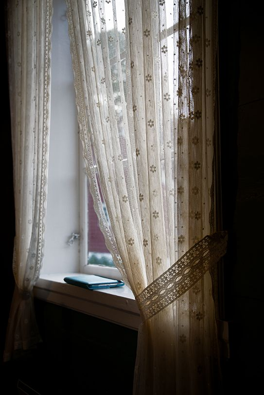 lace curtain at the window, interior view | architectural details