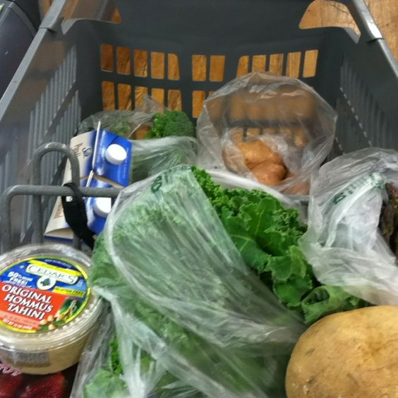A great looking cart of yummy things to eat. Kale, hummus, strawberries, and almond milk for the BBV shakes.  http://ddarmstrong.bodybyvi.com/