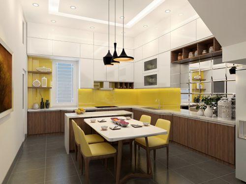 """Khu bếp thông thoáng trong không gian nhỏ Đa số các công trình nhà phố trước đây khu bếp và phòng ăn có diện tích không lớn lắm. Để cải tạo và nâng cấp mỗi không gian đòi hỏi người thiết kế phải có những bố trí sao cho hợp lý. Với mặt bằng công trình nhận được và yêu cầu của chủ đầu tư muốn tận dụng hết khoảng không gian để làm khu bếp kết hợp bàn ăn giải pháp đưa ra là tận dụng toàn bộ không gian bên cạnh tường làm bếp. Nhưng nếu để toàn bộ mặt bằng với kích thước tiêu chuẩn của bếp sẽ mất rất nhiều diện tích do đó trong mục đích sử dụng chính vẫn giữ nguyên kích thước tiêu chuẩn với đầy đủ công năng bao gồm vị trí bếp chỗ để lò vi sóng khu rửa bát kết hợp với các phụ kiện như giá bát liên hoàn giá đựng gia vị dao thớt và các phụ kiện khác. Vậy là phần chính đã đáp ứng đầy đủ công năng ở hai bên cạnh của khu bếp được thu hẹp lại một nửa chiều rộng tủ bếp để không gian sử dụng phòng ăn được nới rộng mà vẫn tạo được khu bếp thông thoáng. Phía tủ trên dùng sơn màu trắng và kính vàng đáy tủ lắp đèn led cho khu bếp luôn sáng. Ngoài kính bếp ốp gam sáng màu tôi kết hợp ốp tấm gương đối diện với khu bàn ăn tạo cho khu vực này cảm giác được rộng hơn. Cạnh tủ bếp dưới gầm cầu thang tận dụng làm chỗ để tủ lạnh side by side mặt thép sáng bóng cho phù hợp. Để thêm chút lãng mạn phía cửa sổ gắn thêm đợt để đồ trang trí. Với không gian vừa phải chúng ta vẫn có thể có được một khu bếp lớn mà không mất đi diện tích sử dụng. Mặt bằng bếp. Mặt bằng bố trí nội thất. Mặt đứng bếp. Nguyễn Ngọc Đức Từ ngày 18/8 đến 15/9 Báo VnExpress phối hợp cùng Công ty điện tử LG Electronics Việt Nam tổ chức cuộc thi """"Ý tưởng cho căn bếp hiện đại"""" dành cho mọi công dân Việt Nam đang sinh sống trong nước có khả năng và niềm đam mê với thiết kế muốn thể hiện và đem ý tưởng của mình đến với đông đảo công chúng. Cuộc thi kéo dài trong 4 tuần. Hàng tuần ngoài giải bình chọn ban tổ chức sẽ chọn ra 3 thiết kế xuất sắc sáng tạo và đáp ứng tiêu chí của cuộc thi để xét trao giải chung cuộc. Gửi bài dự thi tại """