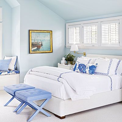 Master Bedroom: monochromatic palette of soft blues. Walls - Benjamin Moore's Sweet Bluette. Fabrics -soft periwinkle. (bed ~ Mitchell Gold, bedding ~ Matouk, benches ~ Romo fabric, Pillow fabrics ~ China Seas, David Hicks, and Lee Jofa. ) CoastalLiving.com
