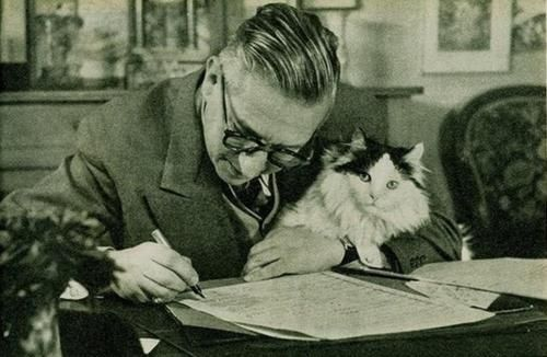 darlingromanov:    Jean Paul Sartre at his writing desk. With existentialist kitty.