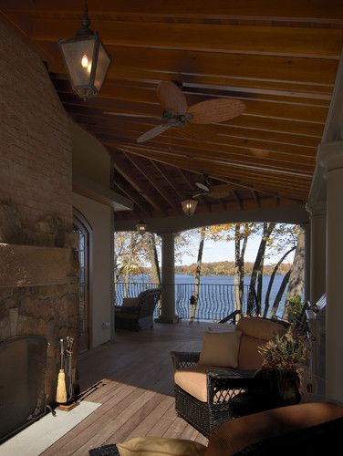 nice deep porch and framing of view, fireplace, that it wraps the corner, has steps to lower level. Wish it had screens