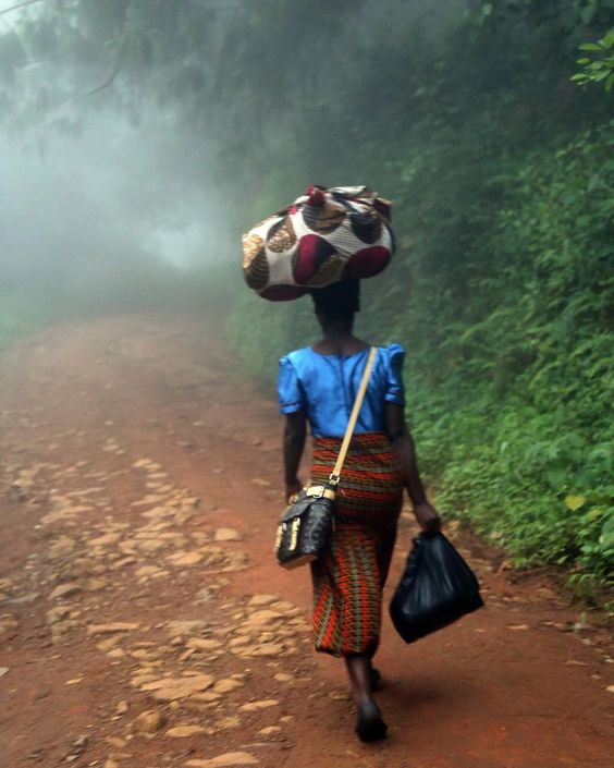 A woman journeys through Zomba mountains with her luggage. Southern Region, Malawi. ©Eva Metelkova