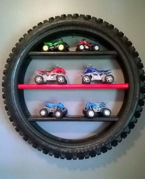 Gift or Game Room Decor. Tire Display Shelf. A big tire, if sliced thinly. Also consider bicycle, Indy tires, ... esp. if damaged and can only salvage partially.