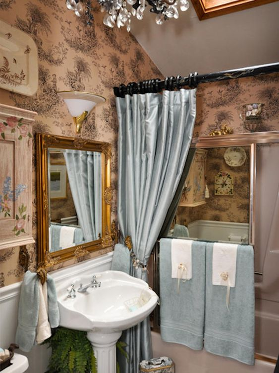 This elegant bathroom sports tan and black toile wallpaper for Beige and black bathroom ideas
