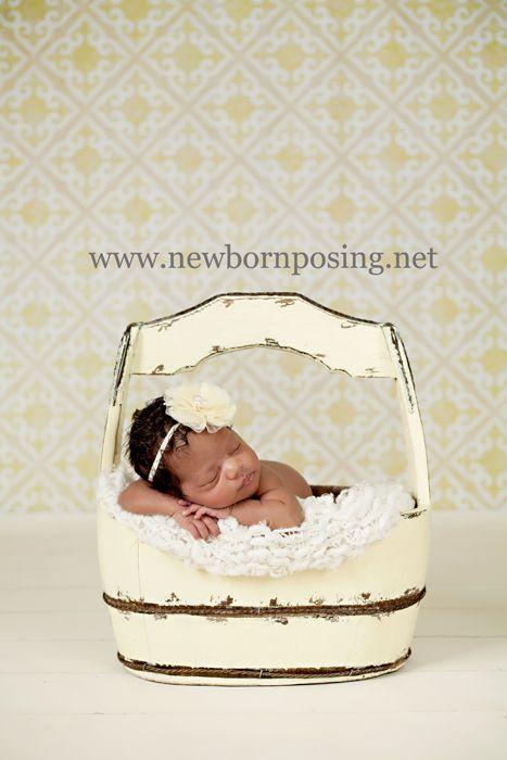newborn in cream bucket    www.newbornposing.net