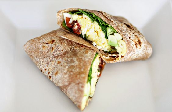 breakfast burritos with eggs, fresh herbs, roasted tomatoes, avocado and goat cheese. yum!