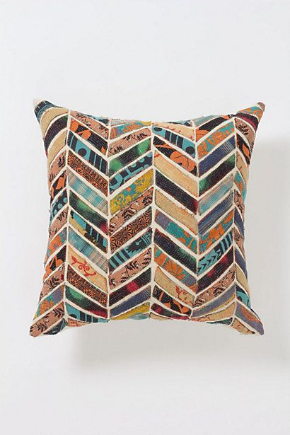 Orimono Pillow, Flower, Anthropologie. DETAILS Jewel-tone prints reminiscent of Japanese yukatas are cut into rounded petals and patched atop cotton canvas. No two pillows are exactly alike.
