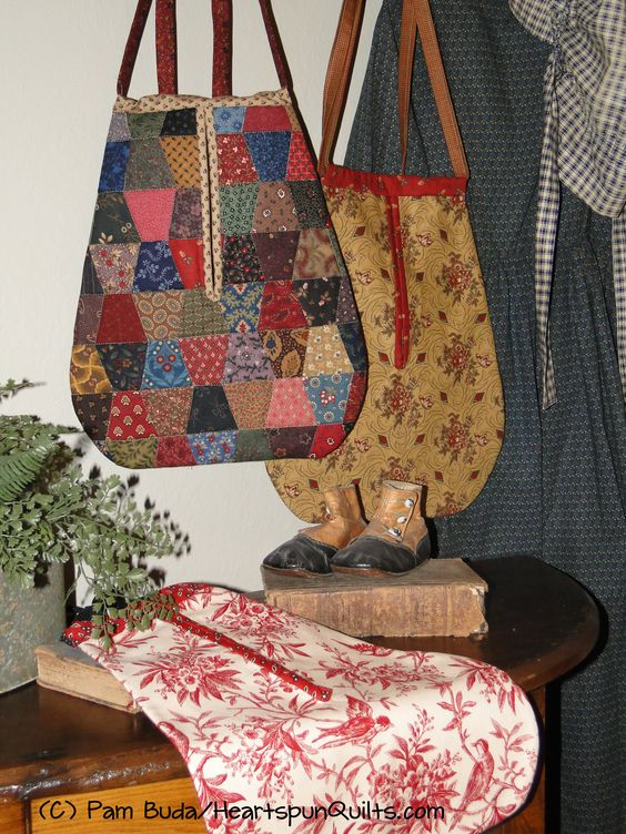 Lucy's Prairie Pockets pattern by Pam Buda/Heartspun Quilts.  Pockets were a staple for women and children in early American life, and this pattern features 1 whole fabric and 2 pieced versions, in 2 sizes, of this piece of vintage American history.