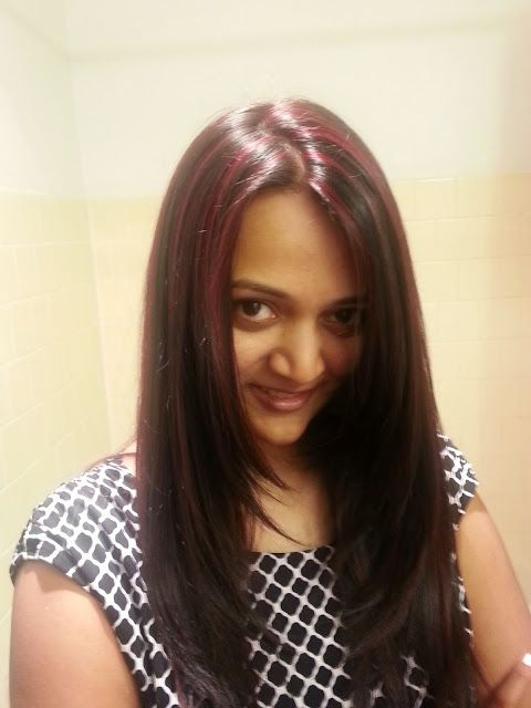 indian girl with red highlights red color on black hair