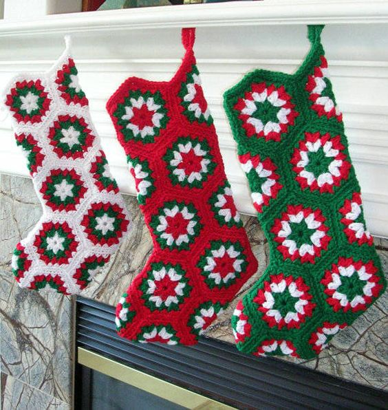 Crochet Christmas Stockings Sold on Etsy by BernoullisAttic.  I think I'm going to have a try of making these though - looks to me like 16 african flower motifs.  It could all go horribly wrong though!