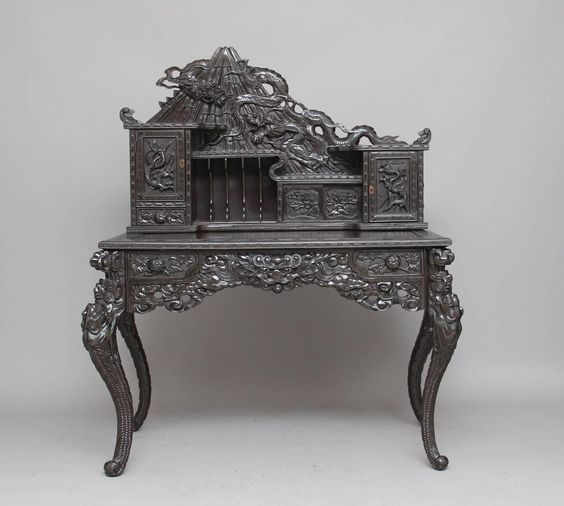 Early 20th Century Carved Chinese Hardwood Desk   From a unique collection of antique and modern desks and writing tables at https://www.1stdibs.com/furniture/tables/desks-writing-tables/
